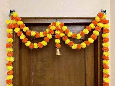 Sphinx artificial marigold fluffy flowers garlands big door toran yellow and dark orange 2