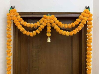 Sphinx artificial marigold fluffy flowers garlands big door toran light orange 2