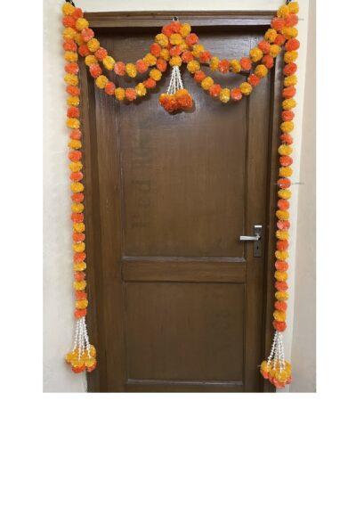 Sphinx artificial marigold fluffy flowers and tuberose (rajnigandha) big door toran light and dark orange 1
