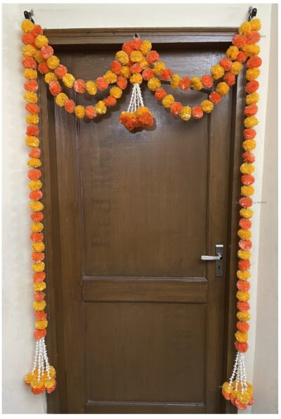Sphinx artificial marigold fluffy flowers and tuberose (rajnigandha) big door toran light and dark orange 2