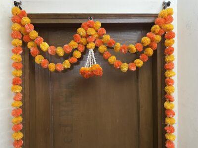Sphinx artificial marigold fluffy flowers and tuberose (rajnigandha) big door toran light and dark orange 3