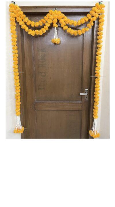Sphinx artificial marigold fluffy flowers and tuberose (rajnigandha) big door toran light orange 1