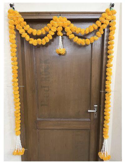 Sphinx artificial marigold fluffy flowers and tuberose (rajnigandha) big door toran light orange 2