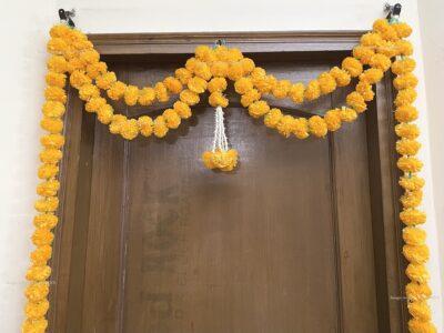 Sphinx artificial marigold fluffy flowers and tuberose (rajnigandha) big door toran light orange 3