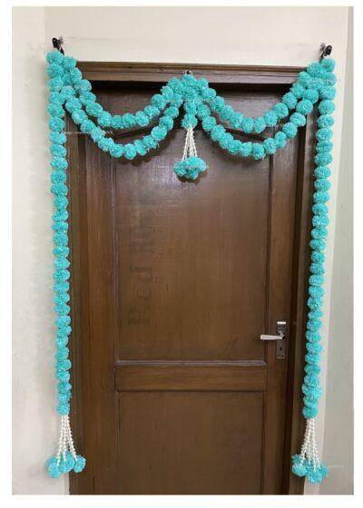 Sphinx artificial marigold fluffy flowers and tuberose (rajnigandha) big door toran sky blue 2