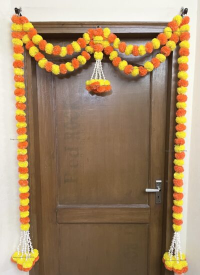 Sphinx artificial marigold fluffy flowers and tuberose (rajnigandha) big door toran yellow and dark orange 2