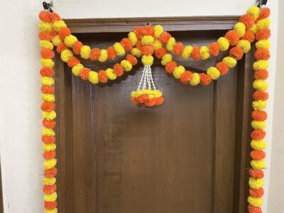 Sphinx artificial marigold fluffy flowers and tuberose (rajnigandha) big door toran yellow and dark orange 3