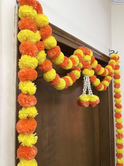 Sphinx artificial marigold fluffy flowers and tuberose (rajnigandha) big door toran yellow and dark orange 4