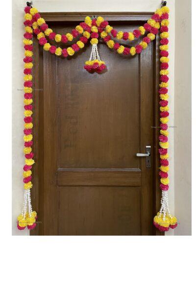 Sphinx artificial marigold fluffy flowers and tuberose (rajnigandha) big door toran yellow and dark pink rani 1