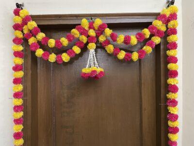 Sphinx artificial marigold fluffy flowers and tuberose (rajnigandha) big door toran yellow and dark pink rani 3