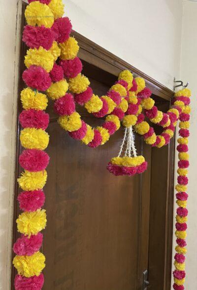Sphinx artificial marigold fluffy flowers and tuberose (rajnigandha) big door toran yellow and dark pink rani 4