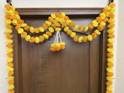 Sphinx artificial marigold fluffy flowers and tuberose (rajnigandha) big door toran yellow and light orange 3