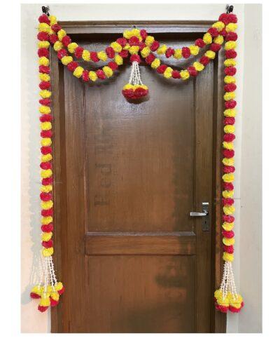Sphinx artificial marigold fluffy flowers and tuberose (rajnigandha) big door toran yellow and red 1