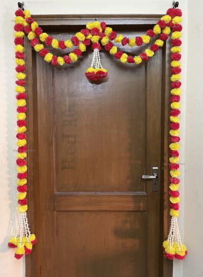 Sphinx artificial marigold fluffy flowers and tuberose (rajnigandha) big door toran yellow and red 2