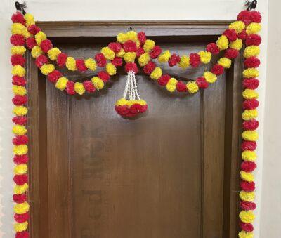 Sphinx artificial marigold fluffy flowers and tuberose (rajnigandha) big door toran yellow and red 3