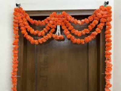 Sphinx artificial marigold fluffy flowers and rajnigandha buds triple line big door toran dark orange 3