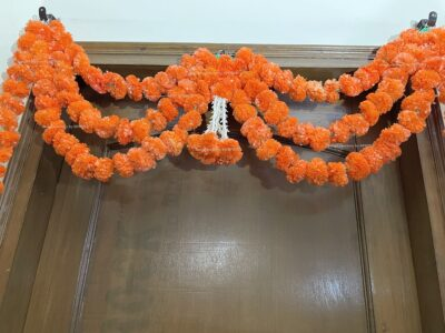 Sphinx artificial marigold fluffy flowers and rajnigandha buds triple line big door toran dark orange 4