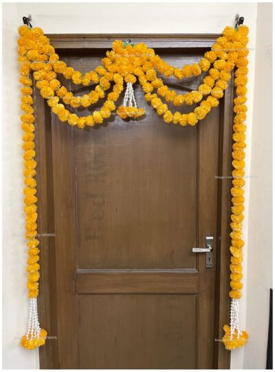 Sphinx artificial marigold fluffy flowers and rajnigandha buds triple line big door toran light orange 2