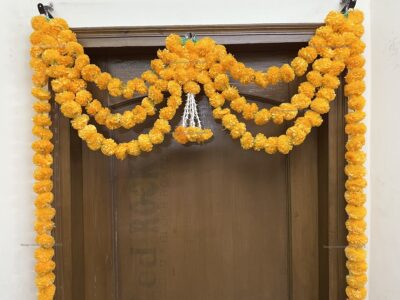 Sphinx artificial marigold fluffy flowers and rajnigandha buds triple line big door toran light orange 3