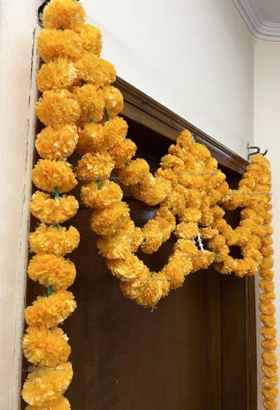 Sphinx artificial marigold fluffy flowers and rajnigandha buds triple line big door toran light orange 5