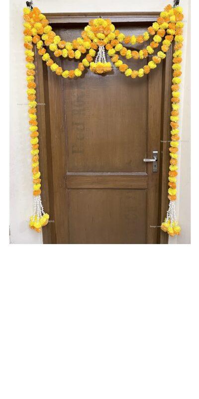 Sphinx artificial marigold fluffy flowers and rajnigandha buds triple line big door toran yellow and light orange 1