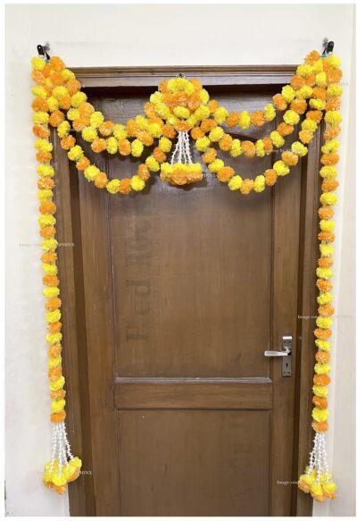 Sphinx artificial marigold fluffy flowers and rajnigandha buds triple line big door toran yellow and light orange 2