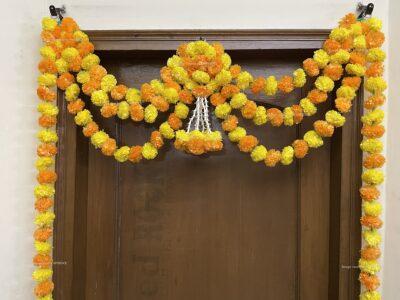 Sphinx artificial marigold fluffy flowers and rajnigandha buds triple line big door toran yellow and light orange 3