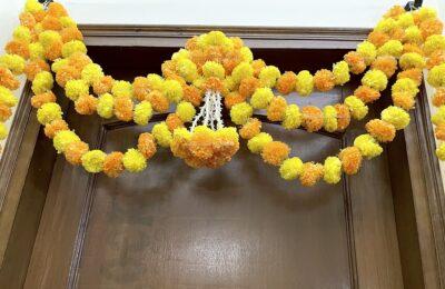 Sphinx artificial marigold fluffy flowers and rajnigandha buds triple line big door toran yellow and light orange 4