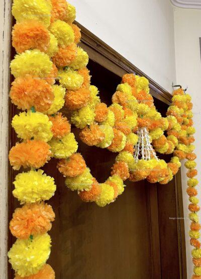 Sphinx artificial marigold fluffy flowers and rajnigandha buds triple line big door toran yellow and light orange 5