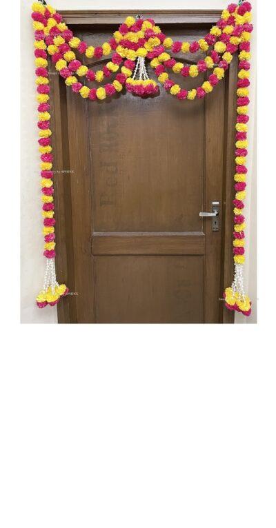 Sphinx artificial marigold fluffy flowers and rajnigandha buds triple line big door toran yellow and rani 1