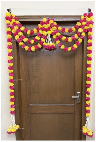 Sphinx artificial marigold fluffy flowers and rajnigandha buds triple line big door toran yellow and rani 2