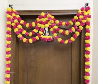 Sphinx artificial marigold fluffy flowers and rajnigandha buds triple line big door toran yellow and rani 3