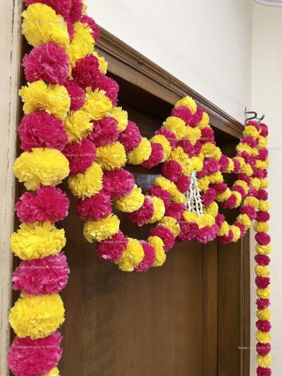 Sphinx artificial marigold fluffy flowers and rajnigandha buds triple line big door toran yellow and rani 5