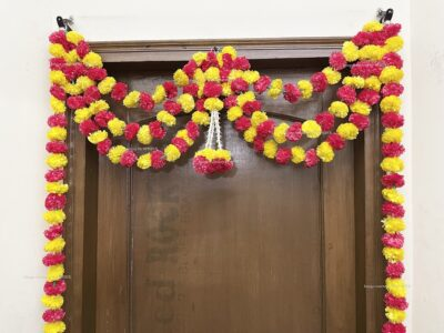 Sphinx artificial marigold fluffy flowers and rajnigandha buds triple line big door toran yellow and red 3