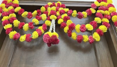Sphinx artificial marigold fluffy flowers and rajnigandha buds triple line big door toran yellow and red 4