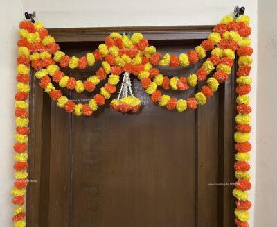 Sphinx artificial marigold fluffy flowers and tuberose rajnigandha triple line door toran 3