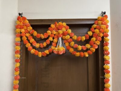 Sphinx artificial marigold fluffy flowers and tuberose rajnigandha triple line door toran light and dark orange 3