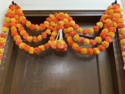 Sphinx artificial marigold fluffy flowers and tuberose rajnigandha triple line door toran light and dark orange 4