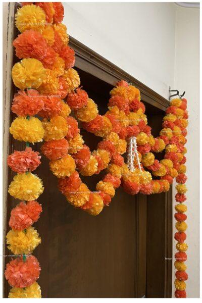 Sphinx artificial marigold fluffy flowers and tuberose rajnigandha triple line door toran light and dark orange 5