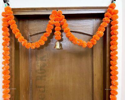 Sphinx artificial marigold fluffy flowers single line door toran set with bell dark orange 3
