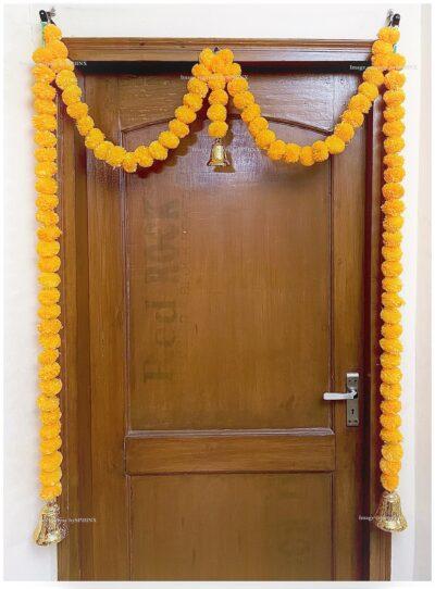 Sphinx artificial marigold fluffy flowers single line door toran set with bell light orange 2