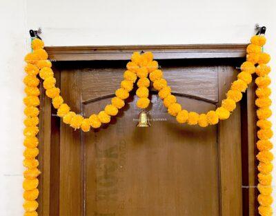 Sphinx artificial marigold fluffy flowers single line door toran set with bell light orange 3
