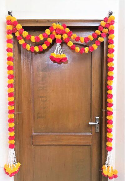 Sphinx artificial tuberose ( rajnigandha) and fluffy marigold door toran set light orange and red 2