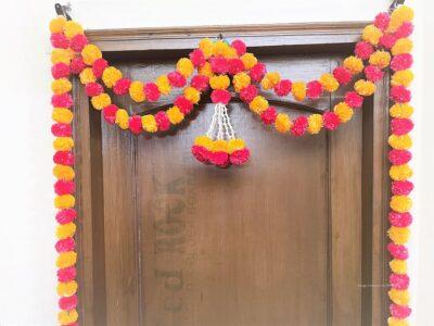 Sphinx artificial tuberose ( rajnigandha) and fluffy marigold door toran set light orange and red 3
