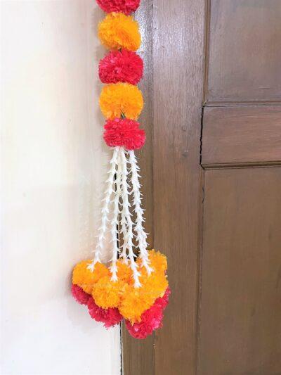 Sphinx artificial tuberose ( rajnigandha) and fluffy marigold door toran set light orange and red 4